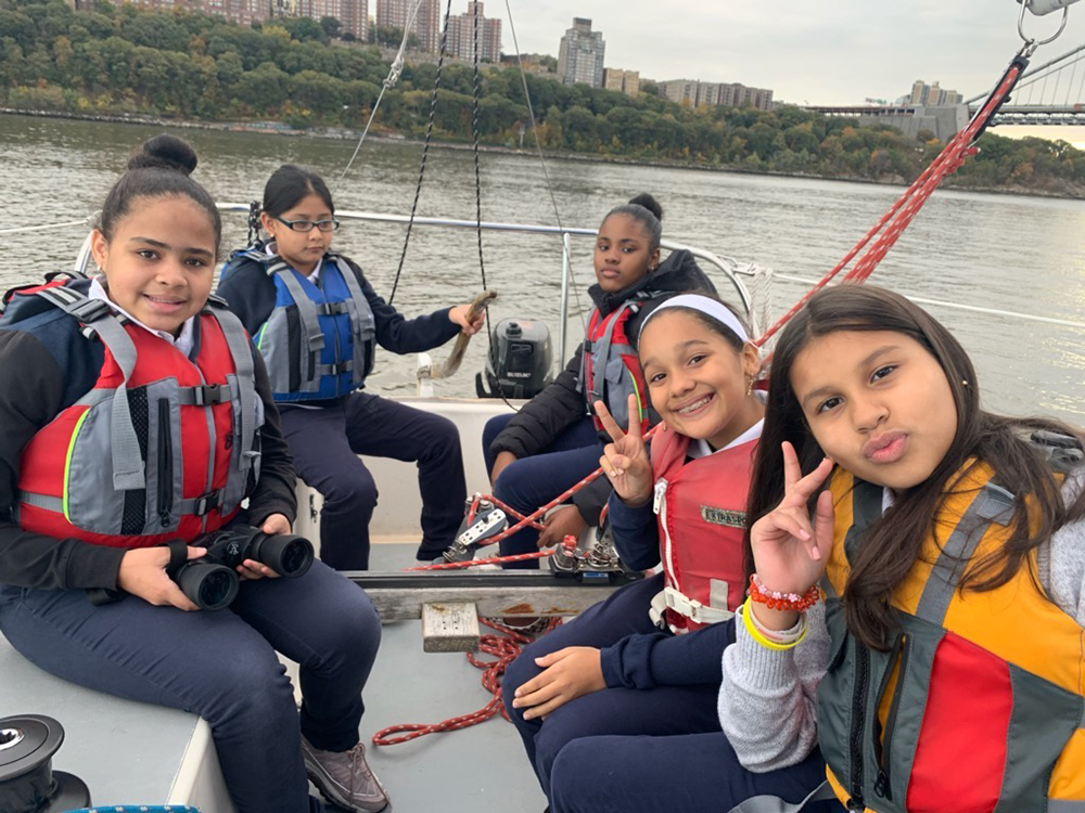 Sail Academy Inwood, students work together to navigate on the Hudson River. Photo credit: Hudson River Community Sailing