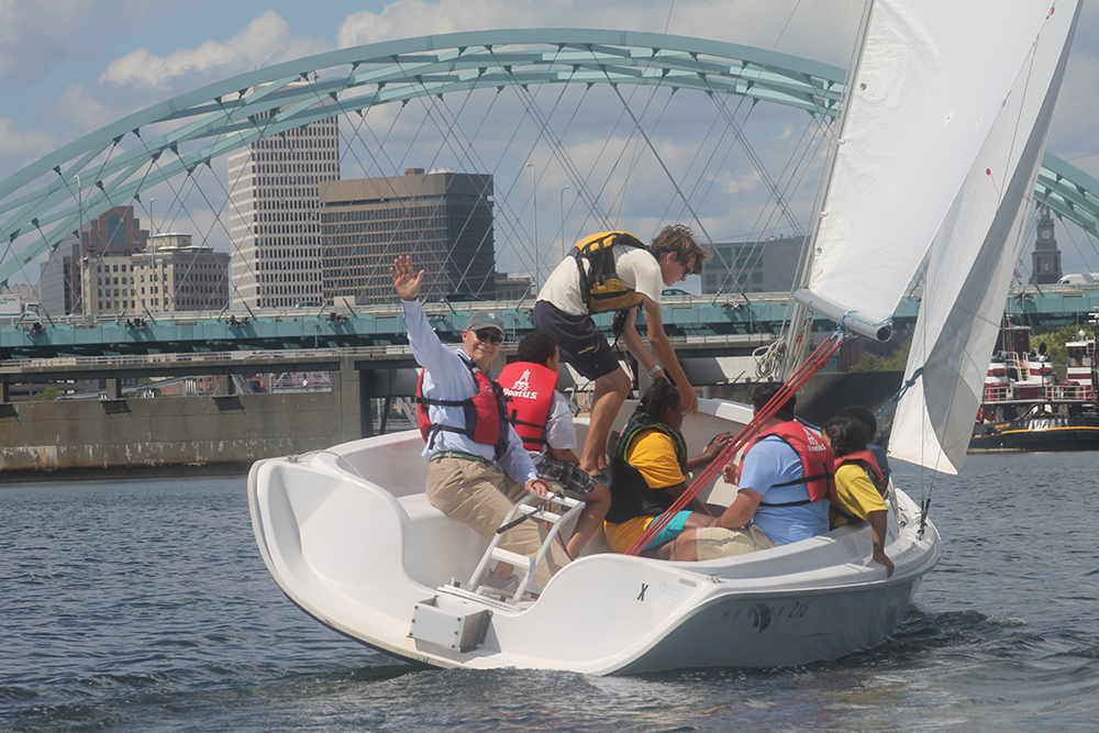 Students and onboard instructor sailing in Providence. Photo credit: Community Boating Center Providence