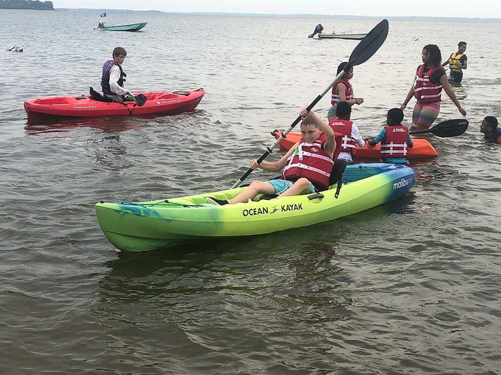 Students kayaking on the Chesapeake Bay. Photo credit: Baltimore County Sailing Center