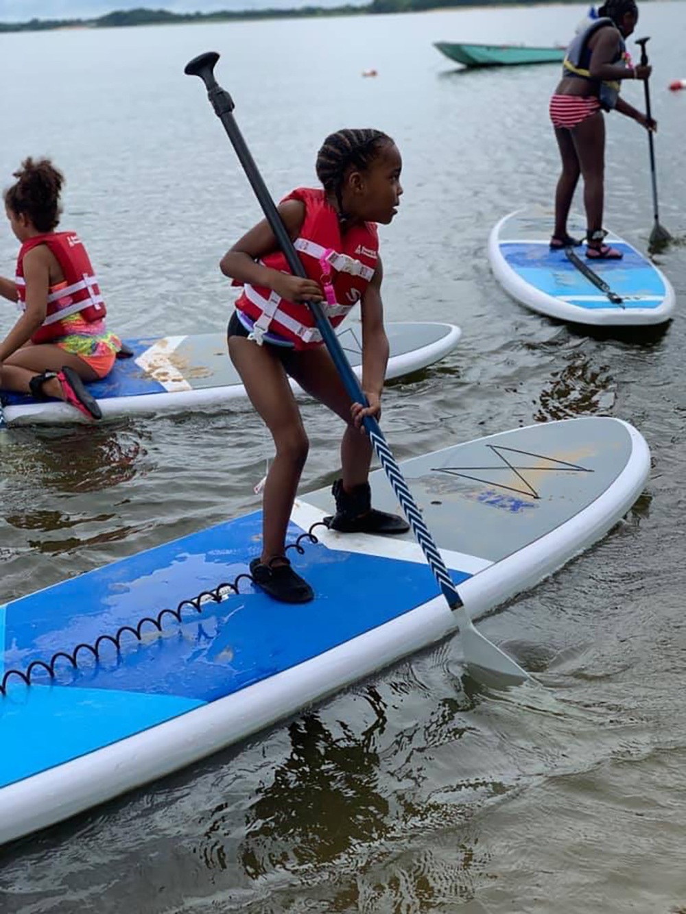 Students paddle boarding on the Chesapeake Bay. Photo credit: Baltimore County Sailing Center