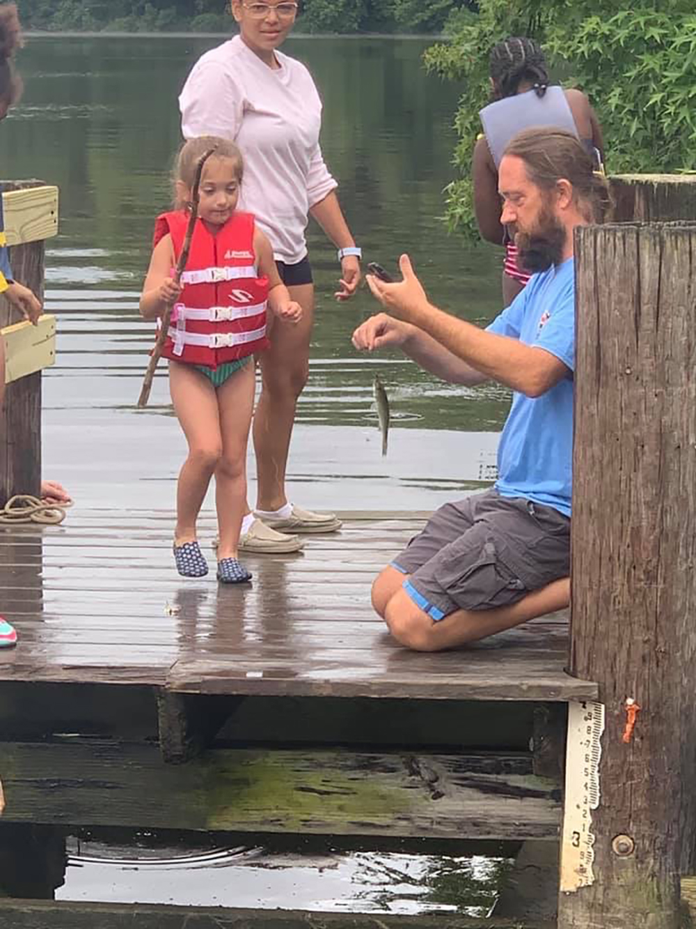 Fishing lesson. Photo credit: Baltimore County Sailing Center