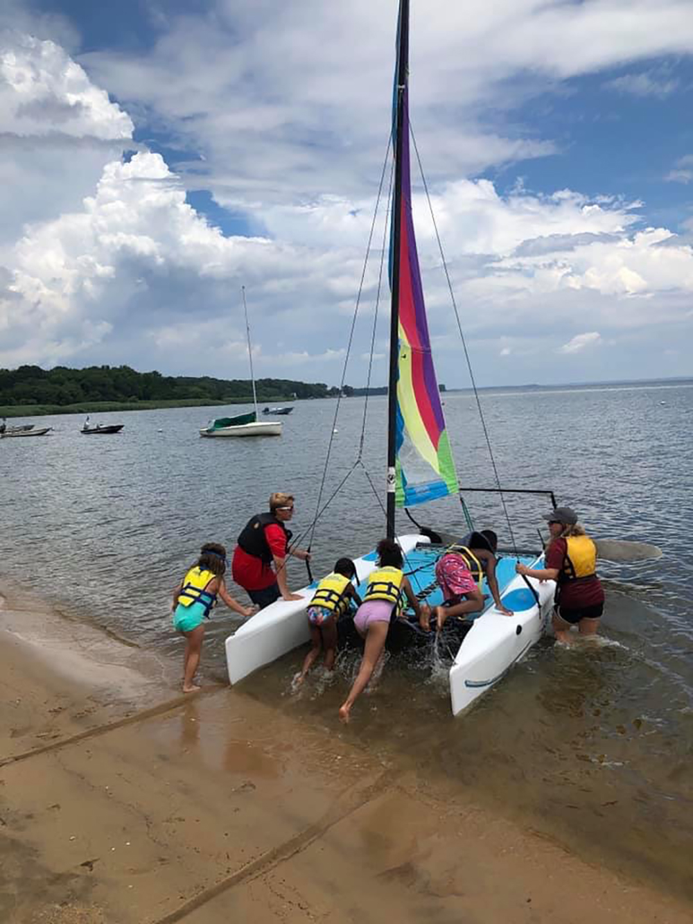 Students launching the catamaran with instructor guidance on the Chesapeake Bay. Photo credit: Baltimore County Sailing Center