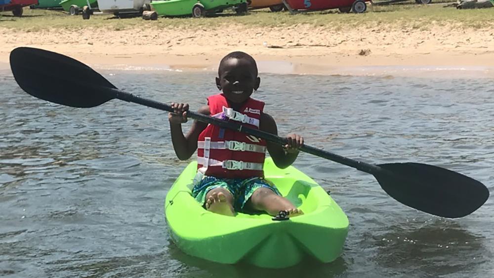 Student kayaking on the Chesapeake Bay. Photo credit: Baltimore County Sailing Center