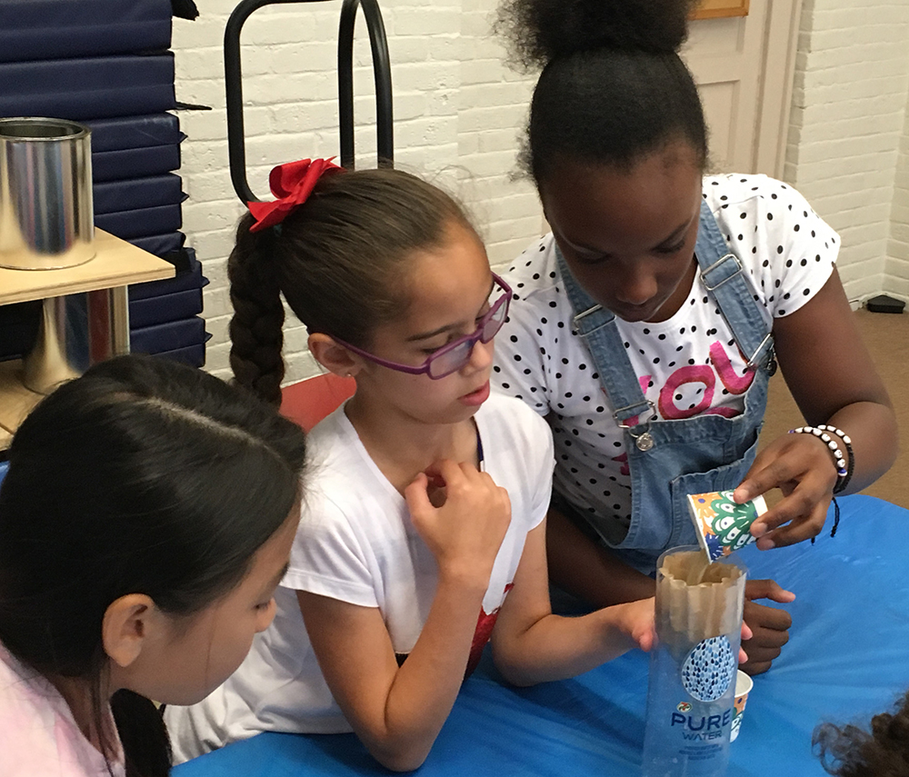 Students testing a water filtration system. Photo credit: Courageous Sailing