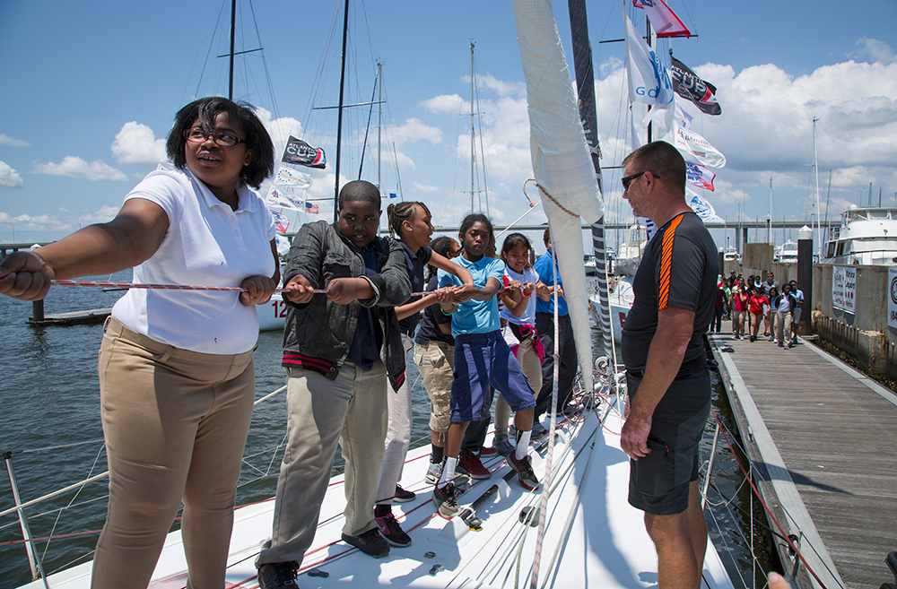 Kids learning the ropes on a Class40 race boat. Credit: Billy Black | Atlantic Cup