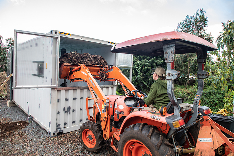 Transferring waste to the in-vessel composting system in Hawai'i. Rafael Bergstrom | Sustainable Coastlines Hawaii 2021