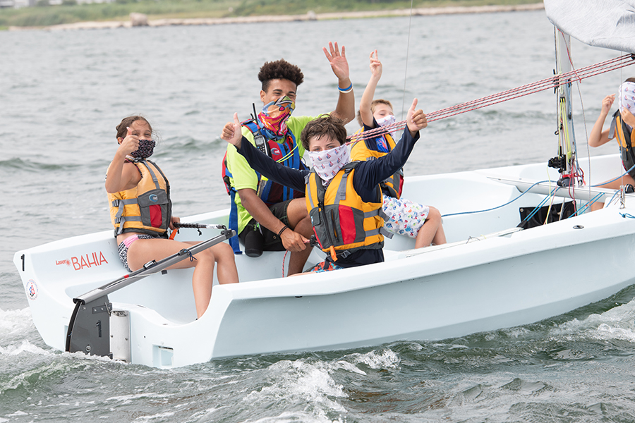 Junior Instructor, Alayjah, teaching students how to sail at CBC New Bedford. Credit: Andy Chin | CBCNB