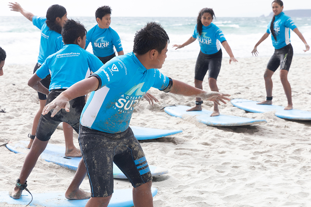 BLAKE Explorers, learning to surf on the beach in New Zealand. Credit: BLAKE